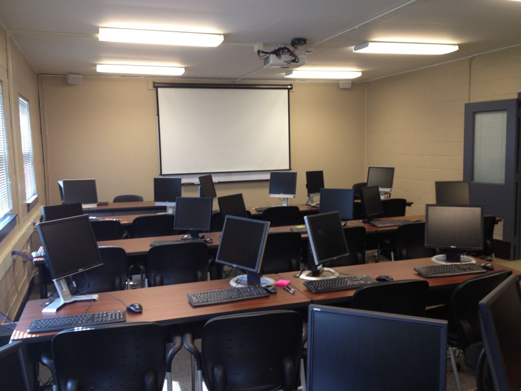 Computer classroom with desks, chairs, projector, and 20 computers